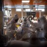 Doctors treat COVID-19 patients in an intensive care unit at the third Covid 3 Hospital in Rome.
