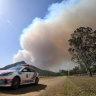 Two worst Queensland bushfires downgraded but danger remains