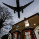 Aircraft come in to land at Heathrow airport over nearby houses in London,