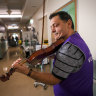 Volunteer violinist's music a tonic for hospital staff and patients