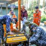 Mount Evelyn resident Therese Harris receives a generator on Monday from an ADF team operating out of Olinda CFA.