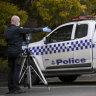 Police car shot, rammed in ambush outside McDonald's in Sunbury