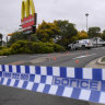 Three charged after police sought cover in McDonald's during ambush