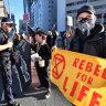 Climate change activists to grind Brisbane to a halt on 'rebellion day'
