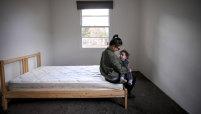Micaela and daughter Harper in a bedroom of their Heidelberg West rental home.