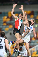 St Kilda's Max King flies for a mark.