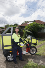 David Archer at work delivering the mail while trialling a new electric buggy.