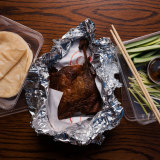The signature crispy roast duck from Holy Duck! in Chippendale.