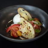 Marrickville Burrata with vine ripened tomato, sourdough wafer, aged balsamic and basil.
