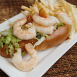 Marinated prawn roll with avocado and fine  pencil-tipped fries.