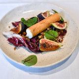 The NGV's Garden Restaurant goat's curd cigars with figs.