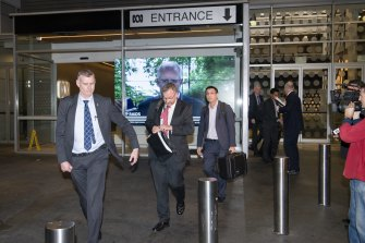 AFP officers depart the ABC studios at about 8.20pm on Wednesday evening after taking documents.