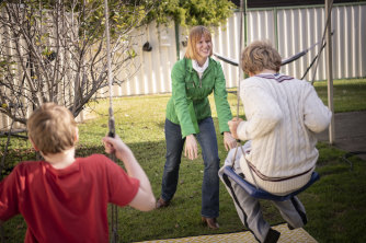 Briana Blackett plays with her two sons, who have autism, in their backyard.