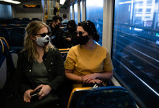 Passengers wear masks on a train between Central and Wynyard.