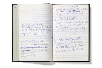 Notebook containing song lyrics for 'And No More Shall We Part' by Nick Cave, 2000