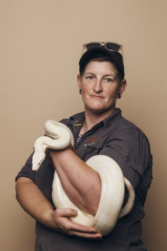 Zookeeper Fran Campbell with an albino red-tailed boa constrictor.