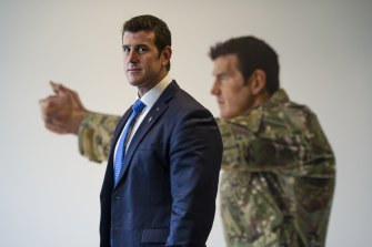 Ben Roberts-Smith and his portrait at the Australian War Memorial in Canberra.
