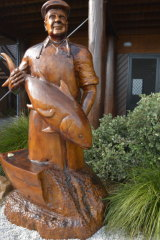 A carving of fishing icon Carmillo 'Poppy' Puglisi at the Bermagui Fisherman's Wharf.