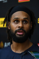 Patty Mills addressing the media in Melbourne.