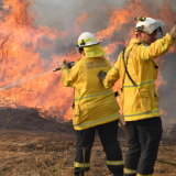 Firefighters continue to fight blazes in the state's north.