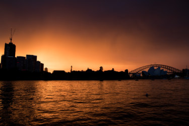 Sydney storm threat eclipsed by spectacular golden sunset