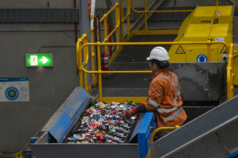 'Keep them loose': Don't bundle your recycling waste in plastic. It can gum up sorting plants, such as Cleanaway's processing facility in Sydney's Eastern Creek.