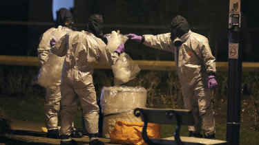 Investigators in protective suits work at the scene in the Maltings shopping centre in Salisbury, England, on Tuesday.