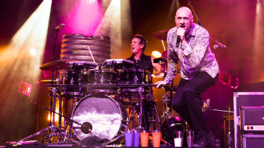 Midnight Oil plays at the Riverstage in Brisbane.