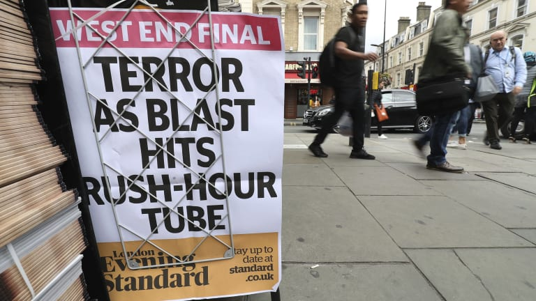 A London evening newspaper poster outside Paddington tube station in London, after a terrorist incident was declared at Parsons Green in September.