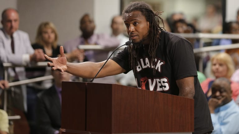 Muhiyidin d'Baha speaks during a meeting with North Charleston city council.