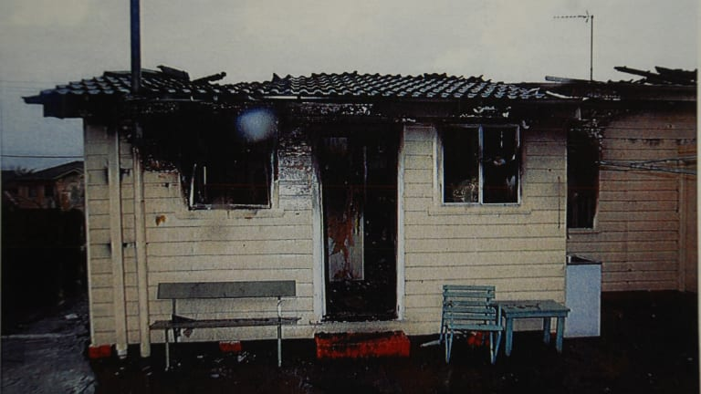 Photos from court documents show the house was reduced to ruins by the fire.