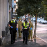 Victoria police and military personnel patrolling Melbourne.
