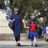 Despite official advice, parents debate whether to pull children out of school