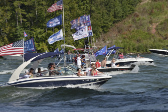 Boat parades, such as this one on Fort Loudon Lake in Tennessee have become a popular method for Americans wishing to demonstrate their support for Donald Trump.