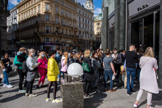 Shoppers in Vienna wait to get into a Zara clothing store opening for the first time since the government imposed restrictions to slow the spread of coronavirus.
