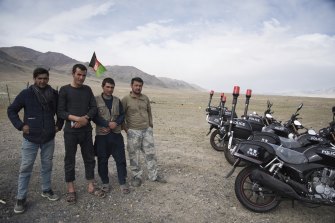 Afghan government soldiers pose with newly-donated Chinese motorbikes at a remote checkpoint in the Wakhan Corridor.