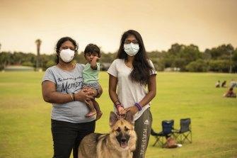 Radha, Parinnitha and Sarrvesh Rajini Kanth with pet dog Cookie at the Brown Park evacuation centre.