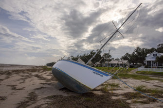 A boat rests on the beach in Bay St Louis, Mississippi after washing aground during the storm.