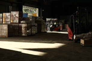 Forklifts load goods onto trucks at the Glen Cameron Group distribution centre.