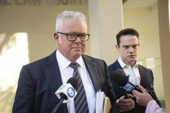 Former WA Treasurer Troy Buswell is approached by media outside a hearing into allegations he assaulted his ex-partner.