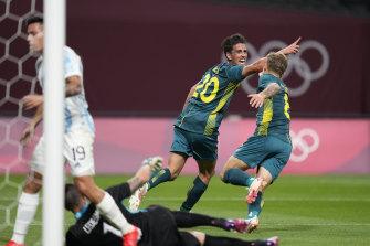 Lachlan Wales celebrates scoring Australia's opener.