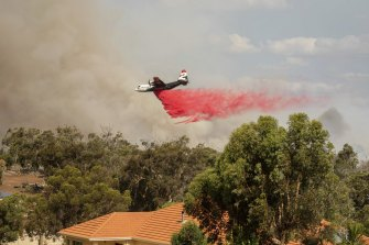 Aerial drops of fire retardant have been essential to the fight against the monster blaze.