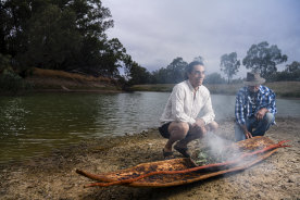Art Gallery of NSW Indigenous educator Wesley Shaw with Barkandji artist Badger Bates at the launch of  Barkandji canoe.