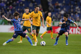 Trent Sainsbury, centre, competes for the ball with Japan's Kyogo Furuhashi, left, and Wataru Endo on Tuesday night.