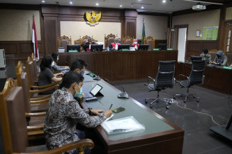 Central jakarta District Court judges read their verdict on a civil lawsuit filed against several Indonesian officials, including President Joko Widodo and Jakarta Governor Anies Baswedan, for their failure to improve poor air quality.