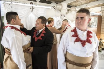 Left to right: Emelio Simpson, Christopher Vaka'uta and Jaiah Simpson preparing for their confirmation and first Holy Communion. They are helped by their grandparents Emelio and Velonika Vaka'uta and wearing traditional Tongan dress to reflect their heritage.