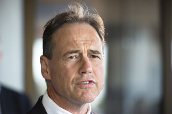 Federal Health Minister Greg Hunt - wants the footy to go ahead.