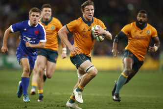 Michael Hooper of the Wallabies runs in to score a try against France.