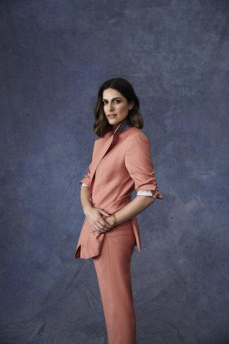 Sarah wears E Nolan suit, Arms of Eve jewellery.