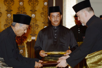 Mahathir Mohamad, now 92, is sworn in by Malaysia's constitutional monarch, Muhammad V.